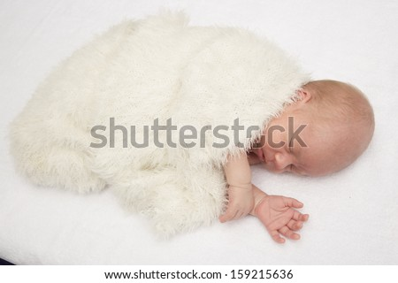 the sleeping baby on a white background - stock photo