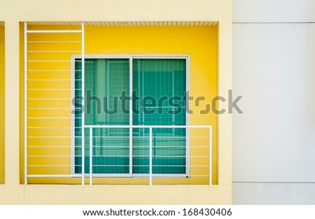 The sliding glass door and balcony of modern building - stock photo