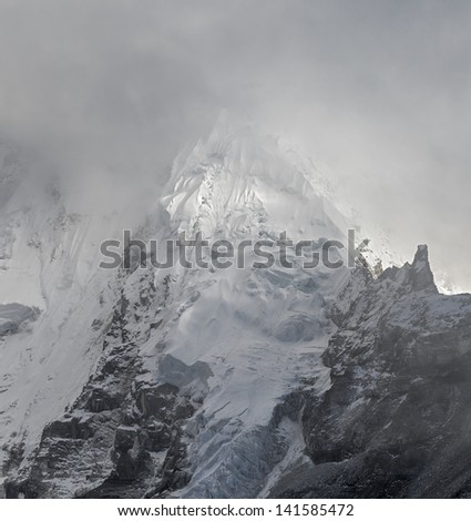 The slope of the Nuptse (7864 m) into mist (view from Kala Patthar) - Everest region, Nepal, Himalayas