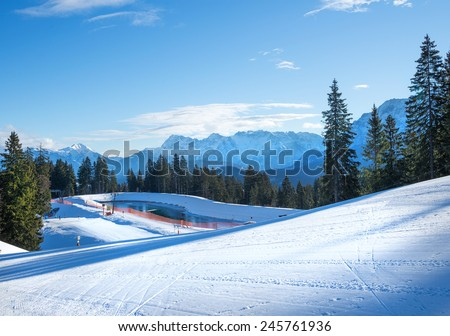 The slopes for mountain skiing at Hausberg top near Garmisch-Partenkirchen town in Bavarian Alps in Germany on a clear winter day - stock photo