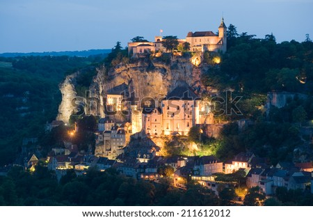 The small and picturesque village of Rocamadour in the twilight - stock photo