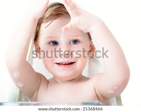 The small beautiful boy of 2 years washes - stock photo
