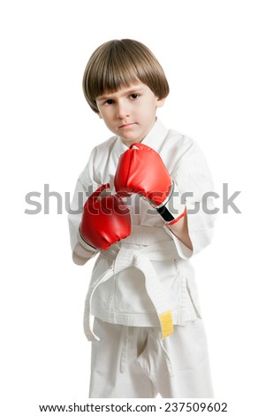 The small boy is boxing, isolated against white background