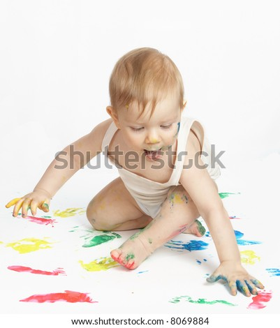 The small child draws water paints - stock photo