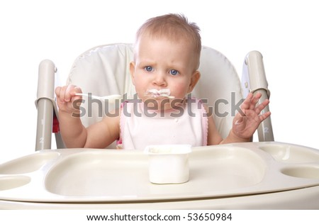 The small child eats independently - stock photo