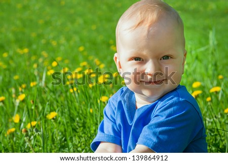 the small child laughs - stock photo