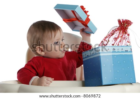 The small child opens a box with a gift - stock photo