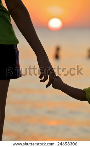 The small daughter holds mum by the hand on a decline - stock photo