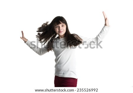 The Small girl in white gown spins, jumps, playing, smiling,  pose on white background. - stock photo