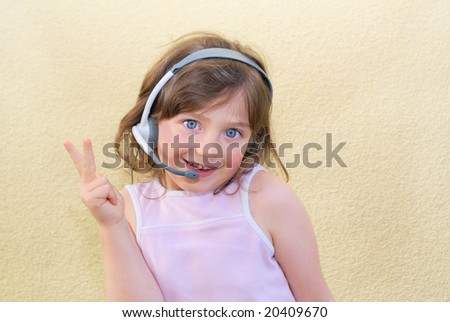The small girl wearing a head to headset.