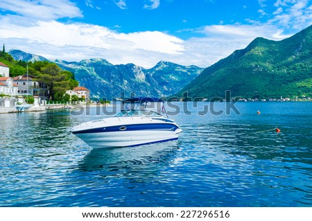 The small motor boat is the best choice for the trips along the Kotor bay, Perast, Montenegro. - stock photo