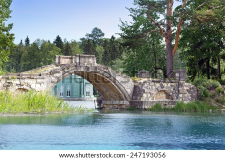 The small shabby bridge in park over a pond. Gatchina. Petersburg. Russia.  - stock photo