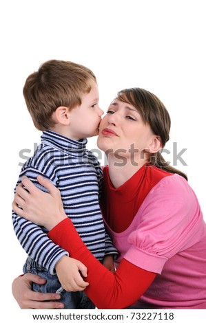 The small son kisses mum. Isolated on white
