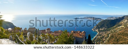The small town of Eze is located  near Monaco and Nice, walking in its exotic garden you can enjoy the plants and perfect view from the top, Provence region, France. - stock photo