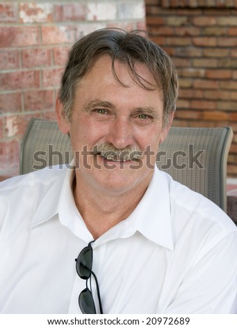 the smiling face of a friendly man - stock photo