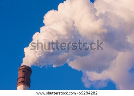 The smoke from the chimney power plant - stock photo