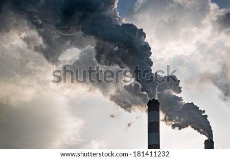The smoke from the chimneys of a power plant