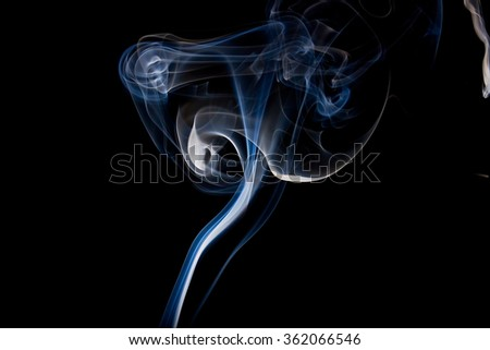 the smoke from the incense sticks  - stock photo