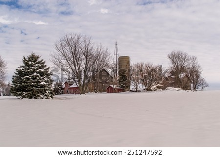 The snow covered rural farm scene in Northern, Illinois. - stock photo