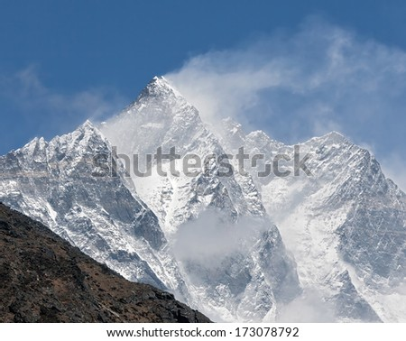 The snow flags on the top of the Lhotse (8516 m) - Everest region, Nepal - stock photo