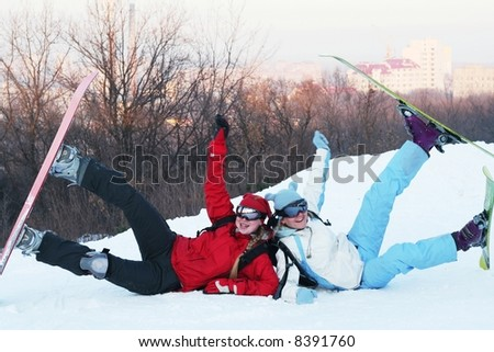 The snowboarder and skier - stock photo