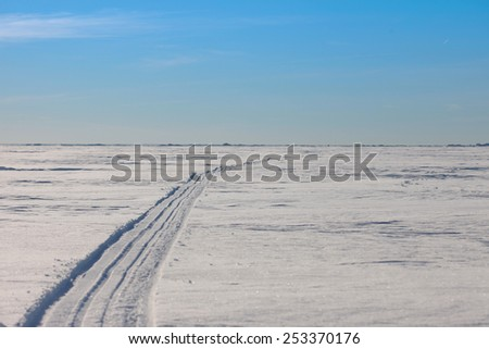 The snowmobile trails in the snowy wilderness - stock photo