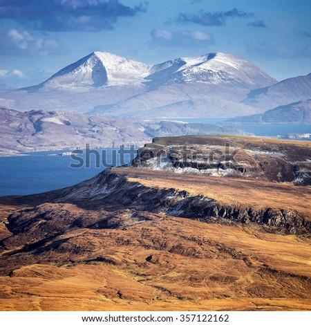The snowy Scottish Highlands skyline shot from the Old Man of Storr at daytime - Isle of Skye, Scotland, UK - stock photo