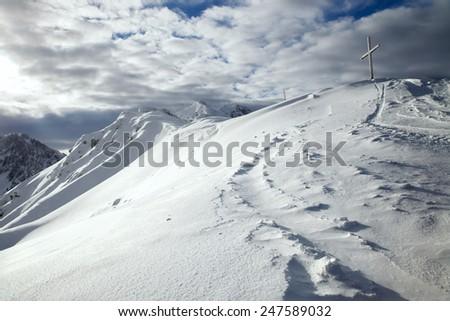 The snowy summit of Joch with wooden cross, Seefeld, Austria - stock photo