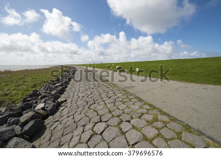 The so-called Wadden dyke on the island of Terschelling in the North Sea in the Netherlands part of the UNESCO World Heritage Program. - stock photo