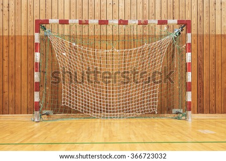 The soccer goal in an old multisport gymhall - stock photo