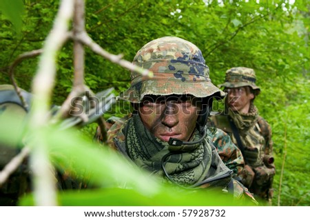 The soldier of the Bundeswehr in the zone of military operations. - stock photo
