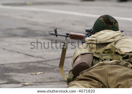 the soldier with an optical rifle - stock photo