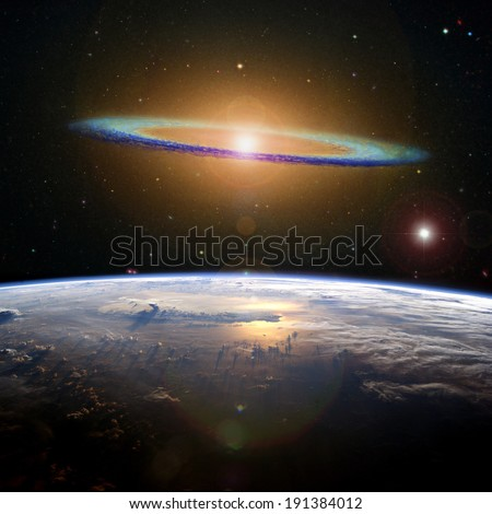 The Sombrero galaxy high above the Earth. Elements of this image furnished by NASA.  - stock photo