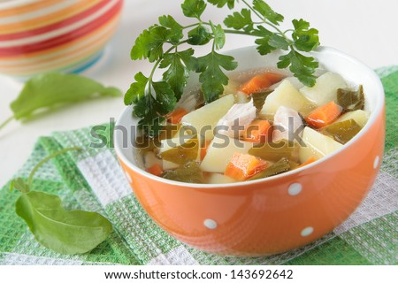 The soup of sorrel and potatoes and chicken pieces