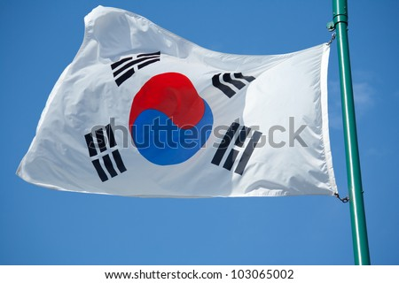 The South Korean Flag with Blue Skies. - stock photo