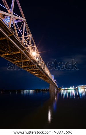 The South 2nd Street bridge over the Ohio River in Louisville, Kentucky, at night in vertical - stock photo