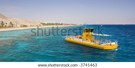 The south of Israel eilat city a yellow boat in the sea - stock photo