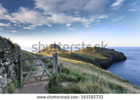 The South West Coast path at The Rumps on the Atlantic Coast of Cornwall - stock photo