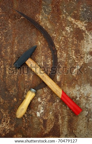The soviet symbol sickle and hammer on rusty  background - stock photo