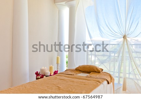 The spa room with massage table and candles - stock photo