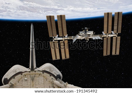The Space Shuttle and International Space Station above the Earth, with stars in the Background. Elements of this image furnished by NASA.  - stock photo