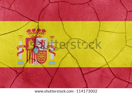 The Spain flag painted on a cracked desert ground surface - stock photo