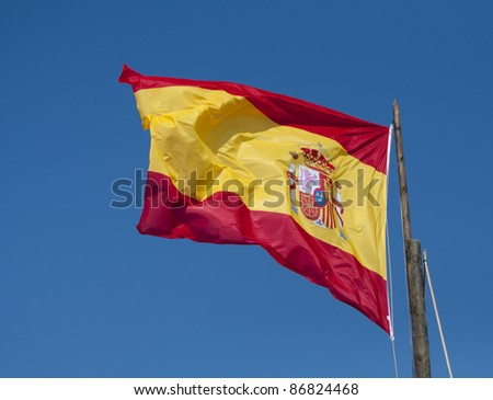 The Spanish National flag blowing in the wind.