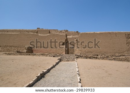 The spectacular Incan Temple of the Sun in Pachacamac, located at the top of a rocky promontory, overlooking the Pacific ocean, is made of four pyramid bodies truncated to superimpose one another. - stock photo