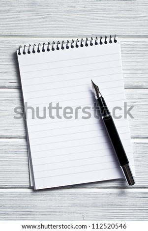 the spiral notebook with fountain pen - stock photo