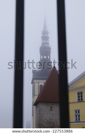 The spire of the church in Tallinn, submerged in winter fog   - stock photo