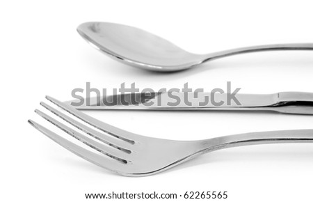 The spoon, knife, and fork isolated on white background - stock photo