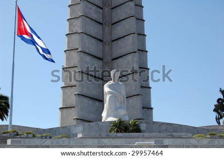 The square is dominated by the Jose Marti Memorial, which features a 109m tall tower and an 18m statue. Located behind the memorial are the closely guarded offices of former President Fidel Castro. - stock photo