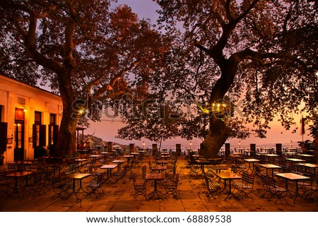 The square of Makrinitsa after sunset. Makrinitsa is one of the most beautiful villages of Pelion mountain, in Thessaly, Greece. Offers great views to Pagasiticos gulf and Volos city - stock photo