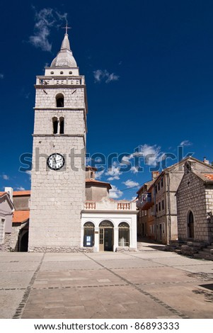 the square with church in city Omisalj - Croatia
